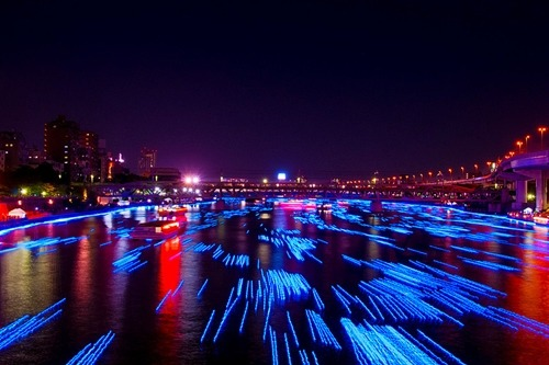 johnny-escobar:  What 100,000 LED's look like floating down a river… I know…totally random. Cool pic tho.