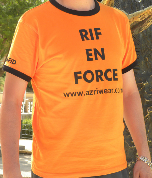"Rif En Force T-shirt. Orange-black Rif en Force men's T-Shirt. Express your rif amazigh identity :) Hafid is wearin ""Rif En Force"" T-Shirt. Photo was taken in Maknes (Morocco). He ask us to put his name on the T-Shirt as well as our URL :)"