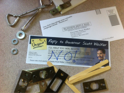 i got a donation solicitation letter from scott walker today along with a postage paid envelope.  rather than simply toss in the recycle bin, i took the opportunity to take a few dollars away from his campaign by sending along some junk from my toolbox (old paint can openers, an outlet cover, strike plates - lots of small, flat, heavy-ish things).  i also drew a mustache & horns on his picture along with a message on the back voicing my displeasure.  i suggest that everyone who gets this at least mail it back blank, but adding some weight and a message is a nice touch.  reblog if you please so we can knock a few $ out of the opposition's coffers.