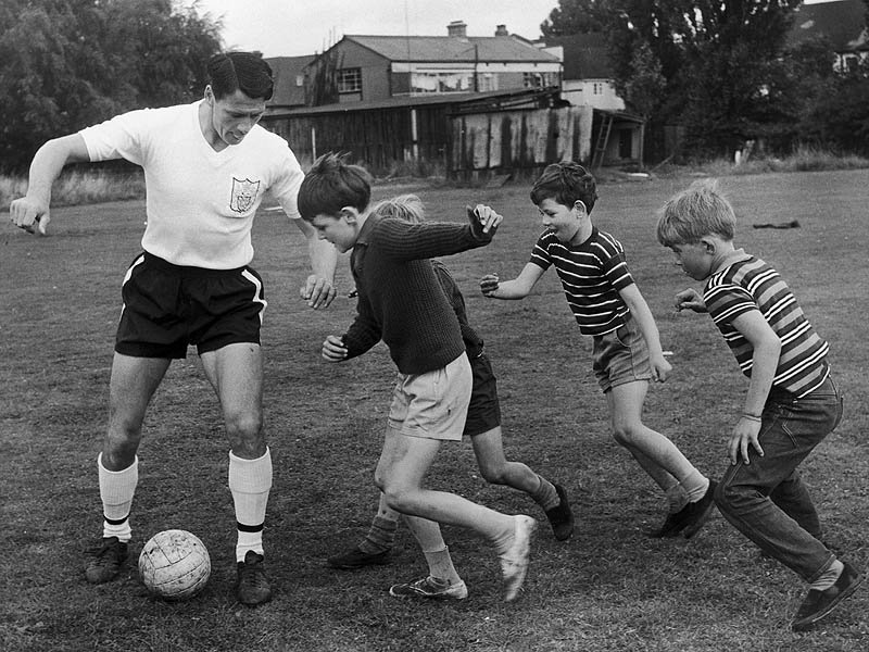 Fulham's Bobby Robson fending off the local rascals, 1966. Source: Football365