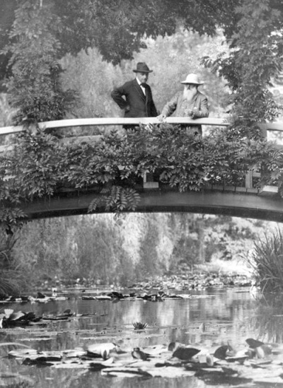 Claude Monet in his garden with an unidentified visitor, Giverny, France, 1922.