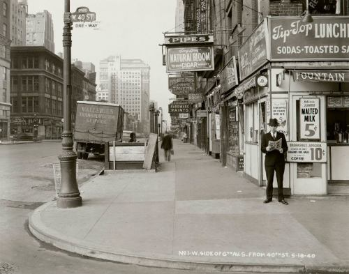 "wnyc:  Sixth Avenue, looking south from 40th Street (Man reading paper: ""Nazi Army Now 75 Miles From Paris""); May 18, 1940 (Courtesy NYC Municipal Archives / Borough President Manhattan) The Brian Lehrer Show is posting a few images from the Municipal Archives each week."