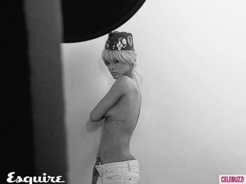 Rihanna poses topless for UK Esquire shoot. See all the pics here.