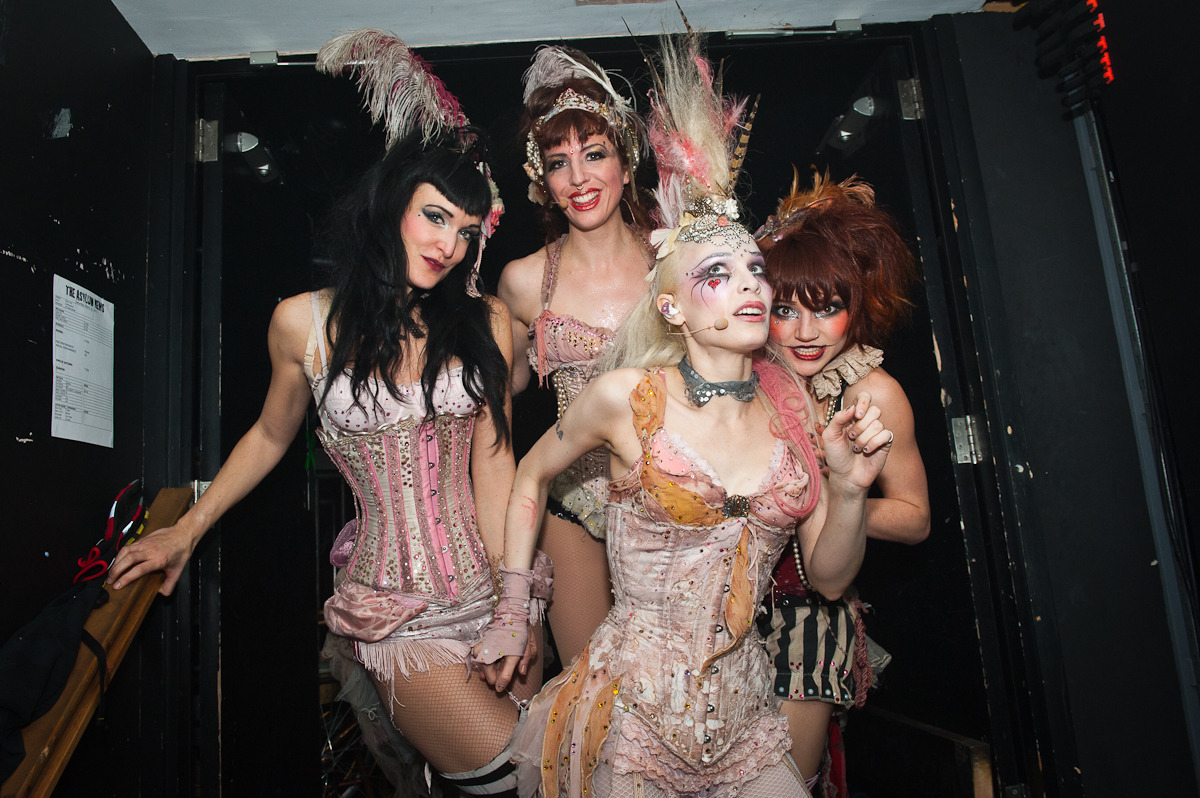 EMILIE AUTUMN backstage at Nottingham Rock City: shot for Rock Sound magazine Emilie Autumn's from LA and mixes a burlesque type show with semi-industrial pop-goth sounds. She may be little known in the mainstream, but she's building a huge cult following. Her crowd is as colourful as she is. Rock Sound did a big live extravaganza spread on Emilie's show at Rock City in Nottingham, so I got to poke around backstage shooting stage props and stuff before she came in, I shot some shots from the stage side - although the cages (yep) kind of got in the way. The shot above was taken as Emilie and her group The Bloody Crumpets (uh-huh) came offstage at the end of 90 minutes of Alice In Wonderland meets Marilyn Manson meets Kate Bush sort of shenanigans.
