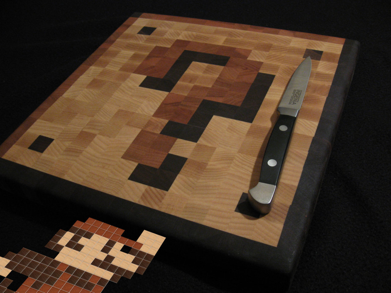 copiouslygeeky:  Coin Block Cutting Board  These are all sold out at the moment, but when he makes more they'll be up on this page.   Do want for my apartment next year :{D