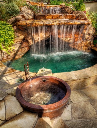 Backyard oasis with hot tub and waterfall pool (via garden)