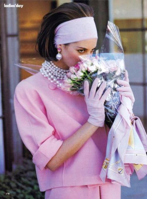 Christy Turlington buys the flowers herself, in Oscar, pearls and an epic headband. from Vogue February, 1990