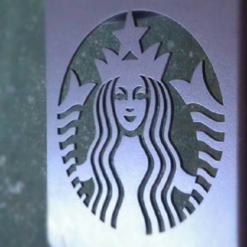 A visit from the Green Mermaid. #NoFilter #Starbucks #architecture #design #LaserCut #steel (Taken with instagram)