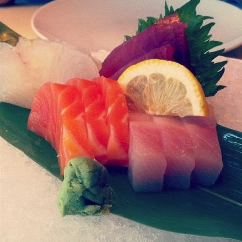 [Foodstuffs] Sashimi at the Pod, Philadelphia Last summer I had a chance to try out some of Philadelphia's best eateries (courtesy of my dad), and was pleasantly surprised to find that the city is quite the foodie's paradise. Much of this is thanks to Stephen Starr, the chef behind many of Philly's classiest restaurants (e.g., Butcher & Singer). Pod is his attempt at Asian fusion; positioned in the University City neighbourhood (home to UPenn & Drexel) it is decidedly modern and hip. For someone who grew up blocks from Toronto Chinatown, an Asian restaurant with this kind of decor was certainly something novel:  But eating here felt strange for other reasons. Mostly, I felt a disconnect between the familiar food items and the unfamiliar dining experience. Like seeing five dumplings artfully placed on a small plate and billed at ten dollars. Or a bowl of pho, a bit more picturesque than what you'll get at your typical Vietnamese place, but half the size at triple the price. I don't mean imply that Asian cuisine can't be classy. Every time I visit China, it's a cycle of banquets and feasts, and I realise that our stereotypes of Chinatown eateries—the less polished service, the average decor—aren't indicative of national restaurant cultures. But I'm not sure how I feel about seeing the dollar items on my dim sum cart or Vietnamese fast food on pricier small plates. That's not to say I wouldn't recommend a lunch at Pod (if nothing else, order the sashimi pictured above—unlike other Asian cuisines, Japanese food lends itself to small plates quite well). Still, there's a certain feeling of comfort that comes with eating these familiar foods in the hole-in-the-wall establishments I've grown so used to. It's similar to how I feel about H-Mart: it's clean and organised, yes, but does an Asian supermarket really feel right without that omnipresent fish smell? Does anyone else feel this way? Or am I just strangely sentimental, or bitter about the price of pho? - Kathy