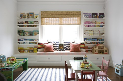 (via window seat flanked by bookcases. great play room. by antonia)