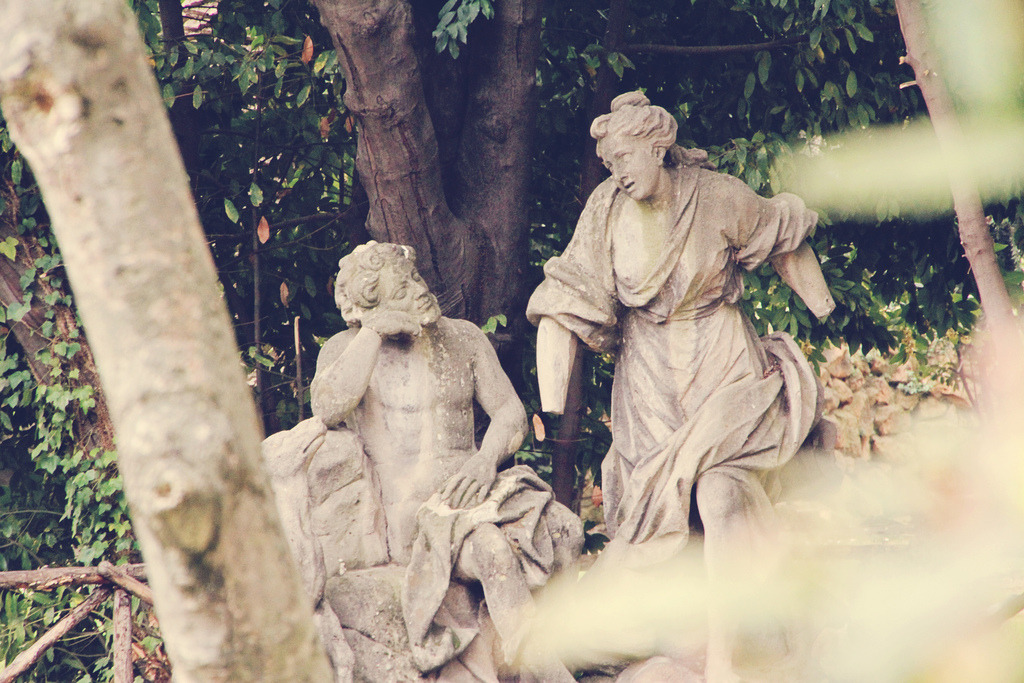 a stolen moment between two rococo statues in the villa sciarra gardens, rome, monteverde, italy, 2012
