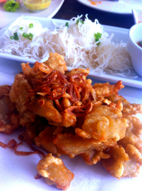 Vietnamese food: deep fried fish and onion served with steamed rice noodle