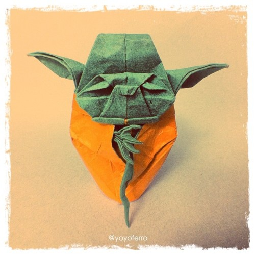I made this 7cm tall Jedi Master Yoda (design by Fumiaki Kawahata) with paper I made with one orange tissue paper sheet glued in a metallic foil sheet and green construction paper on the other side. The photo was taken with my new fisheye lens for iPhone :) #origami #yoda #starwars (Taken with instagram)