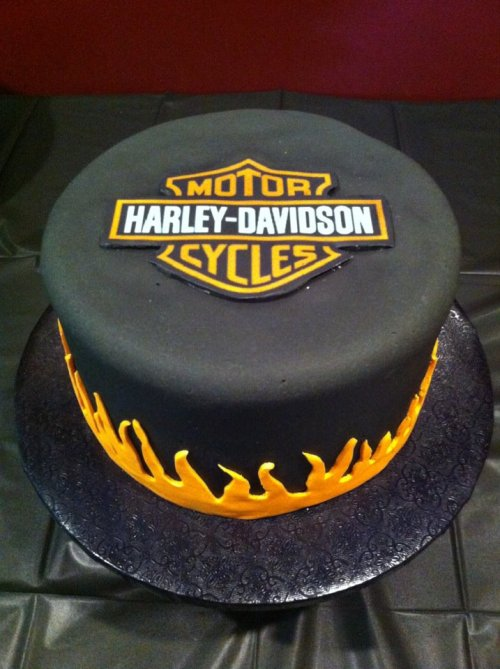 Harley Davidson Cake: harley davidson logo printed on edible paper, flames made with fondant, covered in black fondant