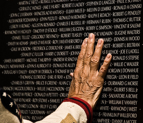 Initially, the names on the Vietnam Veterans War Memorial in Washington, D.C. was presumed to organize the names of fallen heroes in alphabetical order. However, it presented some difficulties upon closer inspection - there were 600 veterans with the last name Smith, and 16 men named James Jones, for example. Listing the names alphabetically would make the names on the memorial indistinguished — the families and loved ones of those 16 James Jones wouldn't be able to tell which James Jones was theirs. The solution, proposed by memorial designer Maya Ying Lin, was to list the names of fallen soliders chronologically by date of death. Not only does this distinguish the deceased for those paying respect, but organizing the names chronologically tells the story of the war - one individual, human person at a time. Instead of looking like a telephone book of listings, each name stands out with the dignity due any individual. In alphabetical order, it would be easy to scan through the names and not feel the impact of 58,000 unique, individual lives lost. Chronologically, in the order each fell, the weight and solemnity is much greater. (information on the memorial taken from Envisioning Information by Edward R. Tufte) Photo: Finding a Name (by Gregory Jordan)
