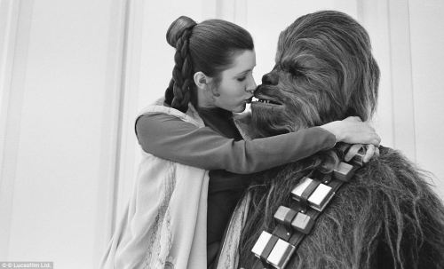 Carrie Fisher and Chewbacca (Peter Mayhew) during filming of Star Wars: The empire strikes back.
