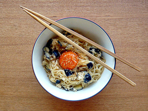 "fuckyeahgreatfoods:   mixed somen  1. boil somen noodle( you can substitute instant ramen noodle or rice noodle for somen). 2. stir fry chopped eggplant and egg white in a pan with vegetable oil, season with miso(with dashi),soy sauce,sake,sugar(or mirin) and ""TURN OFF THE HEAT"". 3. mix 1&2 in the pan, and add lemon juice. 4. serve 3 with egg yolk and grated sesame seeds."