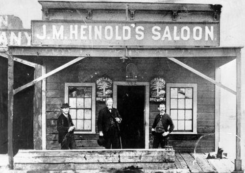 Heinold's First and Last Chance Saloon five years after opening. Oakland, California, 1885. Pictured L to R: George Gibson, Sea Capt. Alfred Burrell, and Johnny Heinold.