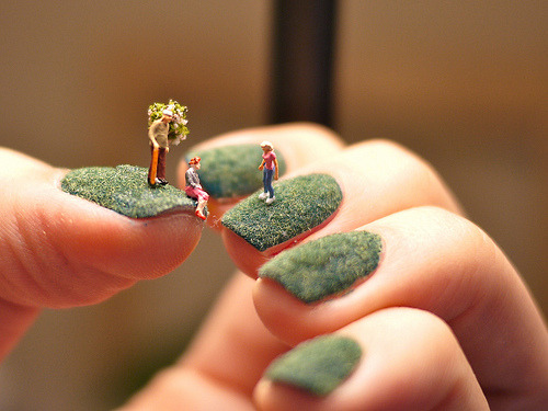 Tiny miniatures on grassy fingernails (by Alice Bartlett)