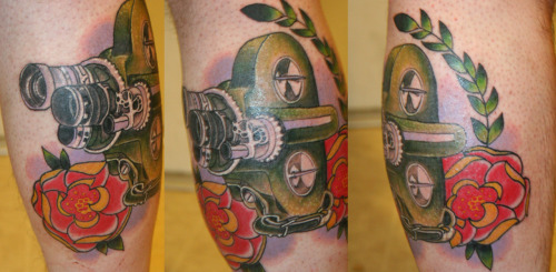 "Got this tattoo on my calf because i am a film student and love cameras. This happened to be the first ""movie"" camera i shot film in. The Bell and Howell Filmo-70DA camera. A mix between photo-realism and traditional. Tattooed by Robbie Lopez at No Regrets tattoo in Tempe Arizona"