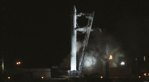 Via the New York Times:  A privately owned cargo rocket launching to the International Space Station was aborted at the last second on Saturday morning.   The rocket's nine engines had ignited, but the computers detected an unnamed discrepancy and shut them down. The next launching attempt will be, at the earliest, on Tuesday at 3:44 a.m.   The rocket and its cargo capsule, both built by Space Exploration Technologies Corp. of Hawthorne, Calif., represent an important step in NASA's evolution to rely more on commercial companies for its human spaceflight program.   If the capsule, the Dragon, reaches the space station, it will be first commercial spacecraft to dock there. All previous vehicles like NASA's space shuttles and Russia's Soyuz capsules were government-operated.   The flight will be a second test in a $396 million development program by SpaceX to develop the cargo ship. If successful, SpaceX will then enter a $1.6 billion contract for a dozen cargo flights to the station.   The SpaceX flight is carrying 1,000 pounds of nonessential cargo, mostly food and clothing.   NASA signed the development agreement with SpaceX in 2006, part of efforts to encourage new commercial space ventures and to reduce launching costs for NASA.   (Photo: Pierre Ducharme / Reuters via the Times)
