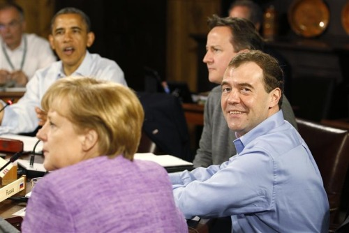 President Barack Obama speaks as Germany's Chancellor Angela Merkel, Britain's Prime Minister David Cameron, and Russia's Prime Minister Dmitri Medvedev listen at the start of the first working session of the G8 Summit at Camp David. Credit: REUTERS/Andrew Winning, May 19, 2012