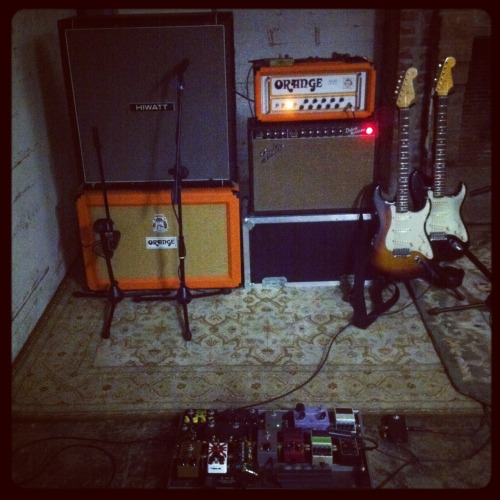 Mike's Rig: Vintage 1965 Fender Deluxe Reverb through Hiwatt 4x12 w/ Celestion Blue Speakers + Orange AD30 through matching 2x12 w/ Celestion Vintage 30s. Running in dual-mono (both on at the same time). Sounds massive.