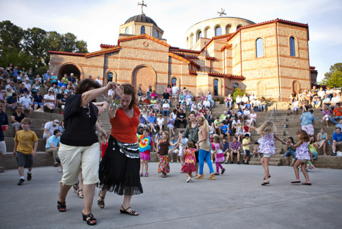 Festival-goers dance in the amphitheater at Holy Transfiguration Greek Orthodox Church as the band plays during the Marietta Greek Festival on Friday. The festival continues today from 10 a.m. to 11 p.m. and Sunday 11 a.m. to 7 p.m. (Photo / Jon-Michael Sullivan, jsullivan@mdjonline.com)