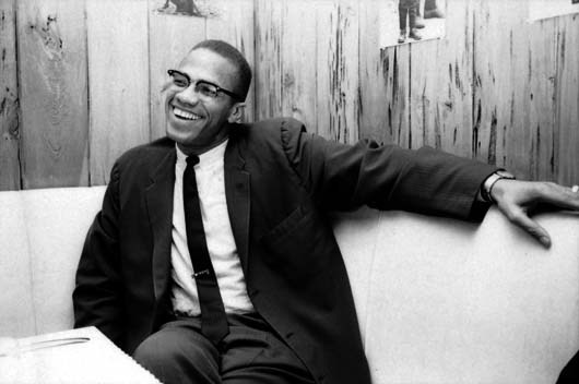 "Happy Birthday to Malcolm X, hero in the struggle of all oppressed peoples against racism and capitalism.  ""It is impossible for capitalism to survive, primarily because the system of capitalism needs some blood to suck. Capitalism used to be like an eagle, but now it's more like a vulture. It used to be strong enough to go and suck anybody's blood whether they were strong or not. But now it has become more cowardly, like the vulture, and it can only suck the blood of the helpless. As the nations of the world free themselves, the capitalism has less victims, less to suck, and it becomes weaker and weaker. It's only a matter of time in my opinion before it will collapse completely.""-Malcolm X"