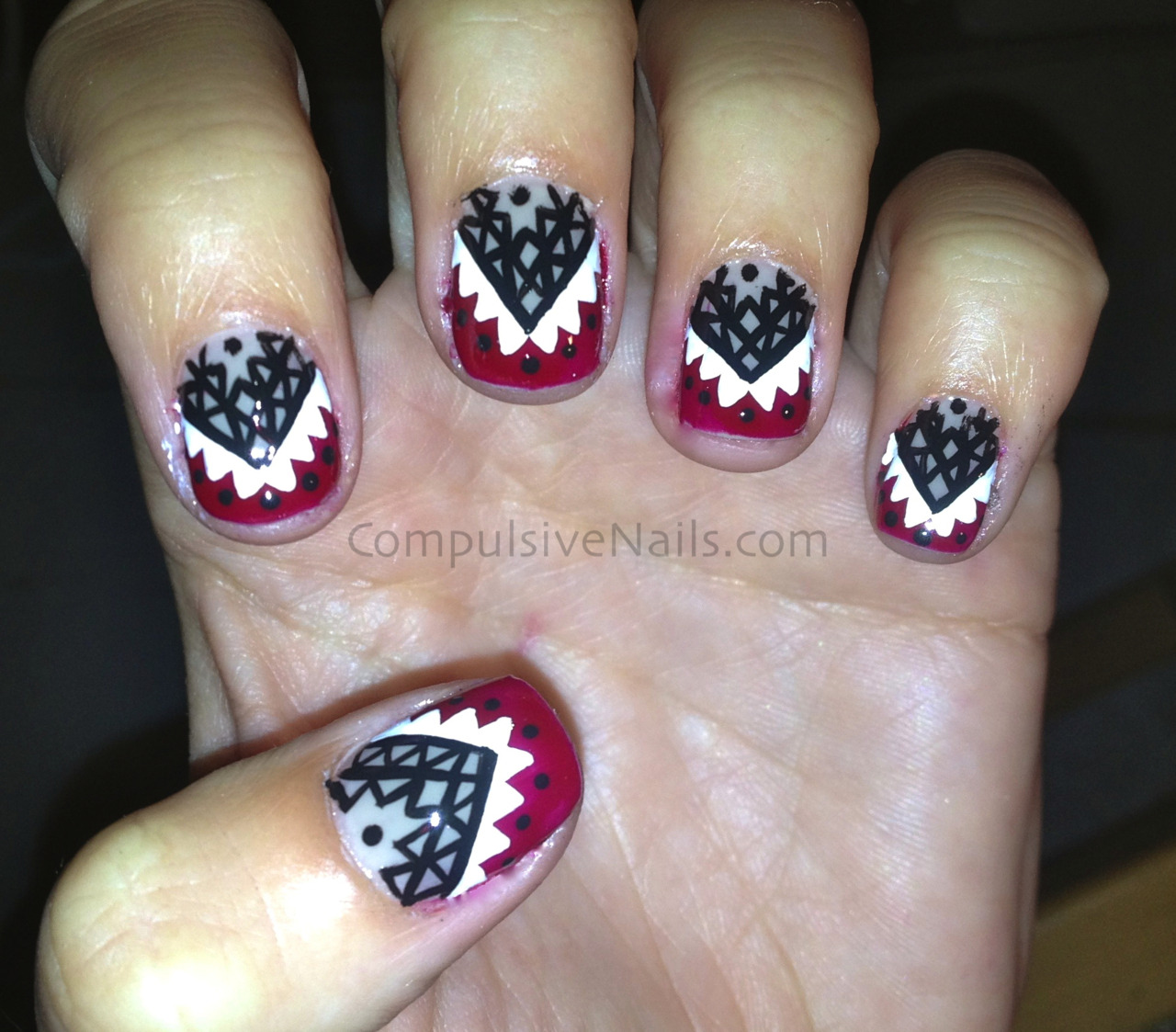compulsivenails:  Some quick tribal nails that I threw on my nails so that they wouldn't be naked :P