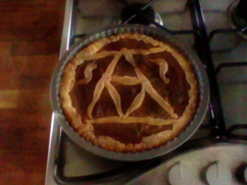 Triforce crostata (Nutella in a lovely biscuitty casing.):Ingredients (enough for 2 lots of dough):- 250g butter- 400g plain flour- 200g sugar- a tip of a teaspoon of vanilla essence- 4 egg yolks- As much Nutella (or other filling) as you like!How to make: - Sift the flour into a bowl and add the butter (straight from the fridge).- Use an electric mixer on its lowest level until the butter turns into small granules (so it looks like one big bowl of flour)NOTE: Alternatively, you can do the above steps by using a food processor.- add sugar and mix briefly.- Form a dent in the middle of the mixture (like a volcano) and add the vanilla essence + egg yolks.- Knead it with your hands! Mix it well, and make one (or two) balls.- Wrap each ball in clingfilm and place in the fridge for at least 30 minutes to let it set.- Grease the tin(s) with butter.- After 30 mins, preheat oven to 180C (160C if fan-assisted).- Take out the dough and roll it. Make as thick/thin as preferred. (Watch out!: If it's too thin it will break very easily in the process of transferring it in the tin!)- Put dough in the tin.- Pour in filling of your choice! :)- Use extra dough to make a triforce/zigzag/pretty drawings on top of your crostata.- Place in oven for ~30 mins. Until golden brown - not burnt!- ENJOY IT! :D