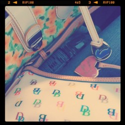 Matching mom & daugther Doonet and Bourke purses~ my purse is the colorful one and the other one is my mom's #mom #and #daugther #dooney #bourke #sunny #beautiful #purses #cl_photography (Taken with instagram)