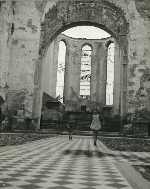 Children playing inside the ruins of a church. Friedrichshafen, Germany - September, 1945