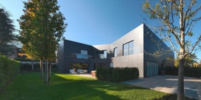 "weandthecolor:  Architecture Inspiration A modern designed house in Sassuolo (Italy), created by Enrico Iascone Architects.  ""The design of the building would enable the construction of two buildings in a single compact volume. It is so designed to cut a box, a closed volume, which bifurcates into two separated to create two separate units, each with its own garden and no introspection. The rooms of the house are arranged around the patio, allowing the penetration of light into the core of the house. The privacy and quiet of the patio is combined with the aesthetic qualities and the expression of elegance by the dark walls.The building structure is made of wood and covered with slabs of thick ceramic panels mounted on a ventilated wall. The roof, made of the same coating material includes the use of plates with integrated photovoltaic roof.""  via: WE AND THE COLORFacebook // Twitter // Google+ // Pinterest"