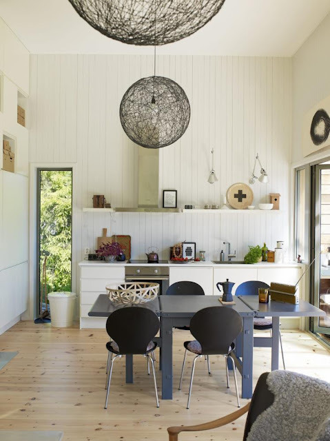 Source: Seventeen Doors Lovely collected kitchen! Great pendant lights - they are call the Random Lights by Mooi and you can find them here!
