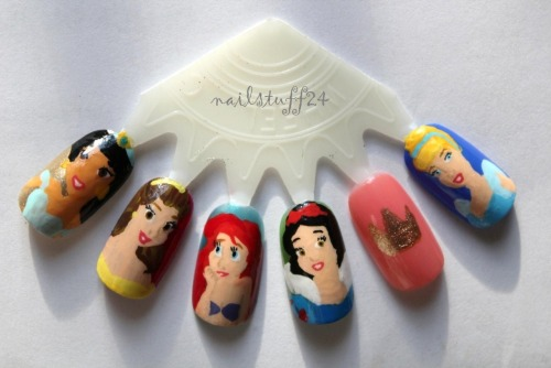 nailstuff24:  I did these a few days after I did my original Disney Princesses nails. I cut up a nail polish color swatch wheel, and tried them again. I think these turned out a kagillion times better than my first attempt!