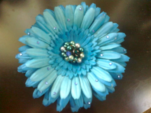 A  brilliant blue daisy hair flower, vintage earring centre and decorated with sapphire swarovski crystals!