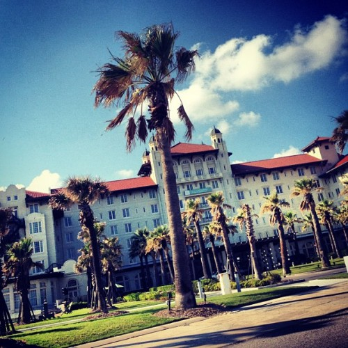 #galveston #palmtrees #tree #hotel #building #clouds #sky (Taken with instagram)