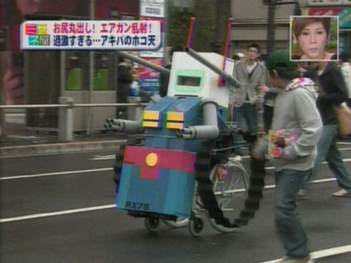 zenigata:  1337470705669.jpg  Guy in a wheelchair turned into a Guntank. It's Doozy Bots.