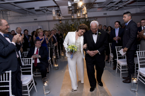 Kim Catullo and father Anthony Catullo walk down the aisle. Photo credit to William Alatriste.