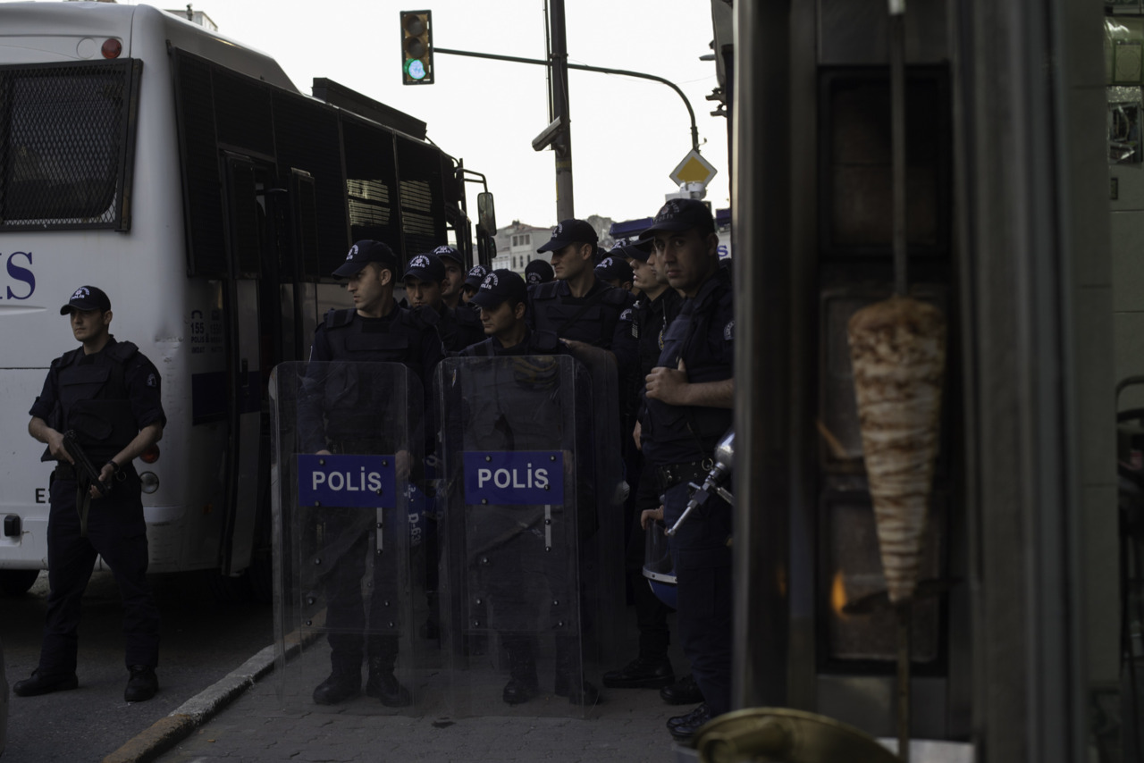 Turkish police prepare to block off portions of Tarlabasi in anticipation of a Kurdish student demonstration commemorating the death of a student two years ago.