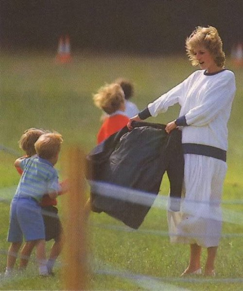 Princess Diana playing with Prince Harry (or Prince William?) and his friend