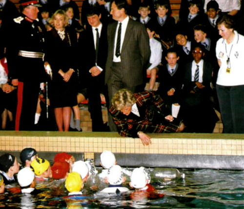 Princess Di talking to swimmers in 1988