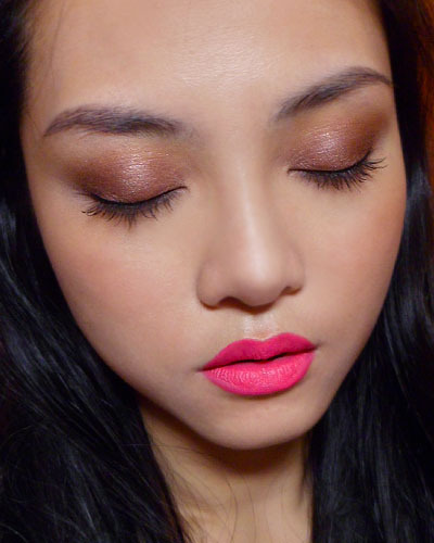 "makeupbox:  Weekend Face: Brown lids, ""Don't Blink Pink"" Lips (Wet n Wild Mega Last Lip Color) —- Got a bunch of Wet n Wild lipsticks from Nonpareilboutique and one of the first I tried was Don't Blink Pink, which is a bright fuchsia pink which is deep enough not to look day-glo on your face, and with just a hint of coral to it so it's not too Barbie either.  Those of you who are afraid of very blue-based pinks can give this a try as it's so affordable. Pigmentation is great and it lasted extremely well through the day. The only minus is that this is a traditional matte texture; meaning it is quite dry and it will drag across your lips a little bit, unlike some of the newer matte textures from MAC etc which don't. Still, the newer matte textures aren't quite as opaque and don't last quite as well, so if you care about the performance more than the feel, then definitely check these out! (Wet n Wild may not be available in some countries except from online stores such as Nonpareilboutique.com and Beautyjoint.com - which I am a little hesitant to recommend for international customers now because I discovered they've jacked up the shipping price a LOT from the last time I bought from them. Do check both sites and compare shipping charges to your country before you buy.) Other products used -  Eyes: MAC Paint Pot in Constructivist Chanel Eyeshadow Quad in Spices Bourjois Liner Pinceau 16 Hr in Black Maybelline Great Lash Mascara (regular formula) Cheeks: MAC Mineralize Skinfinish in Blonde"
