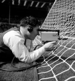 sixtieshistory:  A BBC camera man films through the goal before the 1963 final between AC Milan and Benfica