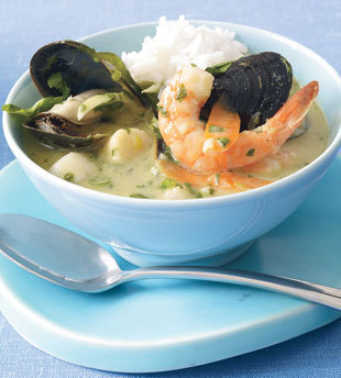 Thai Green Curry with Seafood 4 servings Ingredients  2 tablespoons unrefined peanut oil 5 green onions, finely chopped, dark green parts separated from white and pale green parts 3 tablespoons minced fresh cilantro, divided 3 garlic cloves, minced 6 tablespoons Thai green curry paste 1 1/4 cups water 1 13- to 14-ounce can unsweetened coconut milk 2 small fresh red Thai chiles or 1 red jalapeño chile 2 kaffir lime leaves 1 tablespoon fish sauce (such as nam pla or nuoc nam) 1 large carrot, peeled, thinly sliced on diagonal (about 1 cup) 4 cups thinly sliced bok choy 8 ounces uncooked medium shrimp, peeled, deveined 8 ounces bay scallops 1 pound green or black mussels, scrubbed, debearded 2 tablespoons minced fresh basil 2 cups (about) steamed rice   Preparation   Heat oil in large saucepan over medium heat. Add white and pale green parts of green onions, 1 tablespoon cilantro, and garlic; sauté until tender, about 2 minutes. Add curry paste; cook until fragrant, about 1 minute. Add 1 1/4 cups water, coconut milk, chiles, lime leaves, and fish sauce. Bring to simmer. Add carrot; cover and cook until carrot is just tender, about 5 minutes. Layer bok choy, shrimp, scallops, then mussels in pan. Cover and simmer until mussels open and seafood and bok choy are cooked (discard mussels that do not open), about 5 minutes. Stir in dark green parts of green onions, 2 tablespoons cilantro, and basil.   Divide rice among 4 shallow bowls. Ladle curry over rice and serve