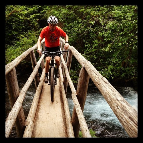 Pretending to ride across a bridge.  (Taken with Instagram at McKenzie River Trail)