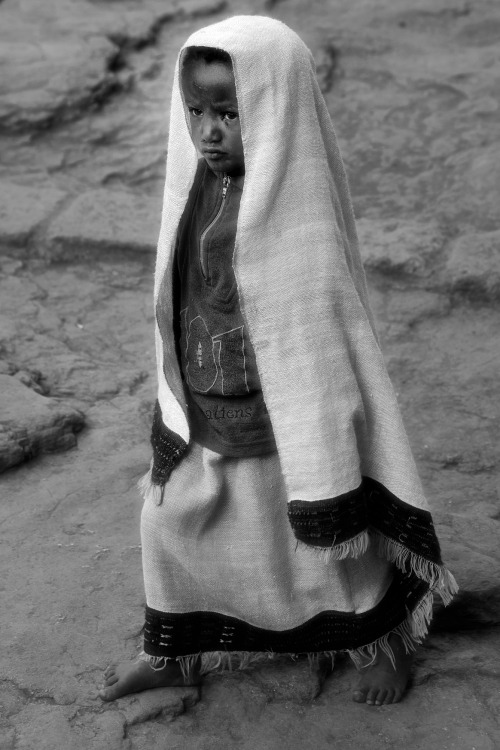 Little girl with a fly in her eye, Lalibela, Ethiopia, April 14, 2012 (c) N.Cambré