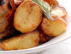 "Perfect roast potatoes  If you get your roast potatoes right your family and friends will love you forever. You may be spending a whole lot more time in the kitchen, but the satisfied sounds that come out of their mouths will make it all worth while. this is fromNigella Lawson, my all time favorite woman chef. You need Roasting potatoes  potatoes will say ""for roasting"" on the bag and in the supermarkets generally the medium size potatoes. Oil, not olive oil, it smokes at a lower temperature. The process Preheat the oven to 220 Celsius and place a rosting tray with the oil in the oven to preheat. (It's vital to have the oil hot before you put the potatoes in) Peel the potatoes and cut into equal size pieces. Boil potatoes for about 10 minutes or until the edges are soft and fluffy. Drain them in a colander and then give the colander a good shake to break up the edges of the potatoes, this is what gives them those crispy edges while being soft and fluffy inside. Place the potatoes into the hot oil with a long spoon to avoid hot splatter and turn each one to get it coated with the oil. Place on a high shelf in the oven and do not disturb them for about 40 minutes or until golden brown. Serve with a good pinch of salt immediately. Try theperfect roast chickenrecipe. MAKE PLENTY."
