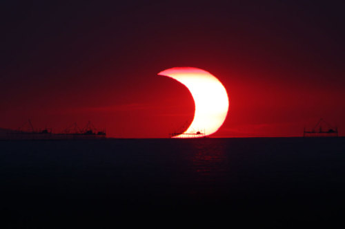 tumblrpigeon:  A Partial Eclipse Over Manila Bay